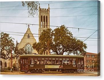 St. Charles Streetcar Driving By Christ Church Cathedral In New Orleans Garden District - Louisiana Canvas Print by Silvio Ligutti