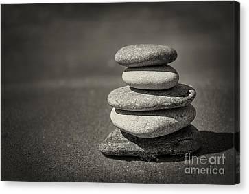Stacked Pebbles On Beach Canvas Print by Elena Elisseeva
