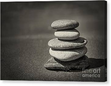 Stacked Pebbles On Beach Canvas Print by Elena Elisseeva