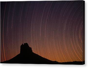 Startrails Over Shiprock In The Four Canvas Print by Tim Fitzharris