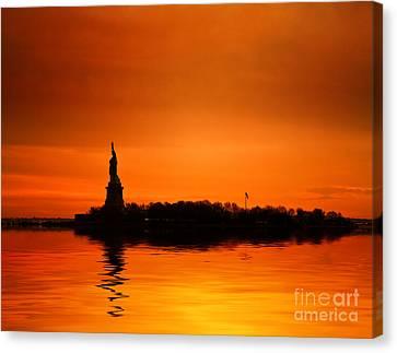 Statue Of Liberty At Sunset Canvas Print by John Farnan