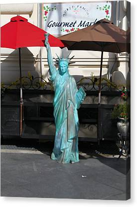 Statue Of Liberty At The Market Canvas Print by Dan Sproul
