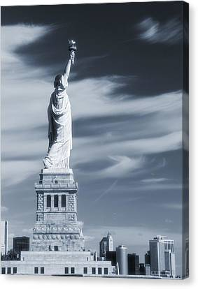 Statue Of Liberty Facing New York City Canvas Print by Dan Sproul