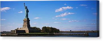 Statue Viewed Through A Ferry, Statue Canvas Print by Panoramic Images