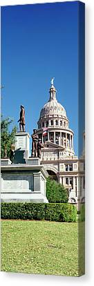 Statue With A Government Building Canvas Print by Panoramic Images