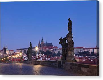 Statues On Charles Bridge With Castle Canvas Print by Panoramic Images
