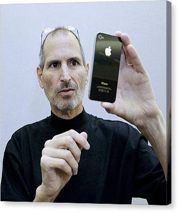 Steve Jobs Holding An Iphone 4 Canvas Print by Science Photo Library