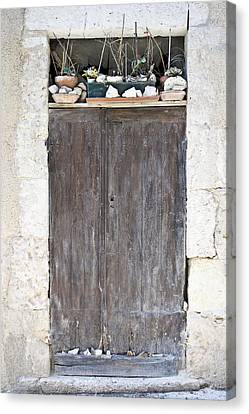 Sticks Stones And An Old Wooden Door Canvas Print by Georgia Fowler