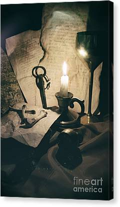 Still Life With Bones Rusty Key Wine Glass Lit Candle And Papers Canvas Print by Jaroslaw Blaminsky