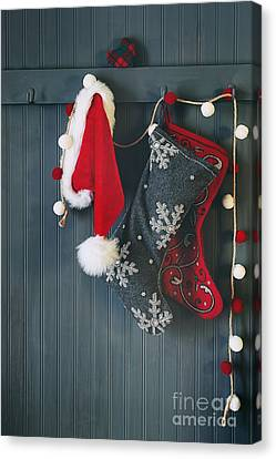 Stockings Hanging On Hooks For The Holidays Canvas Print by Sandra Cunningham