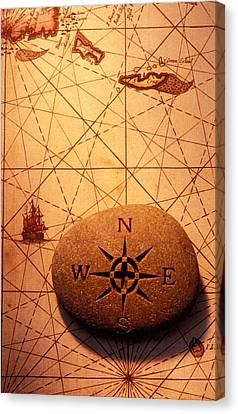 Stone Compass On Old Map Canvas Print by Garry Gay
