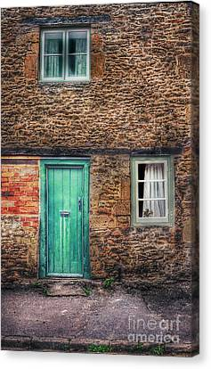 Stone House With Green Door Canvas Print by Jill Battaglia