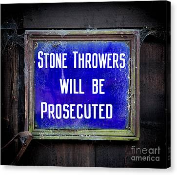 Stone Throwers Be Warned Canvas Print by Adrian Evans