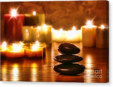 Stones Cairn And Candles Canvas Print by Olivier Le Queinec