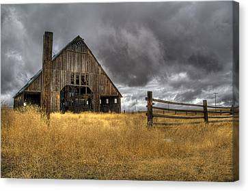 Storm Over Abandoned Barn Canvas Print by Jean Noren