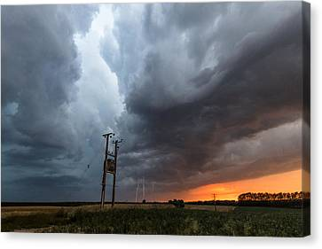 Stormfront At Sunset Canvas Print by Ian Hufton