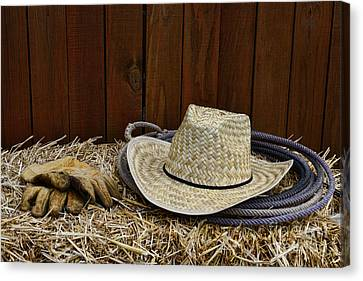 Straw Hat  On  Hay Canvas Print by Paul Ward