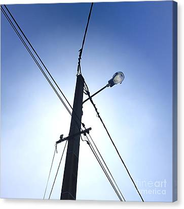Street Lamp And Power Lines Canvas Print by Bernard Jaubert