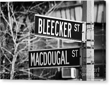 street signs at junction of Bleeker st and Macdougal street greenwich village new york city Canvas Print by Joe Fox