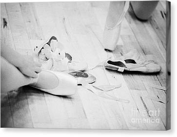 Students Putting On Pointe Shoes At A Ballet School In The Uk Canvas Print by Joe Fox