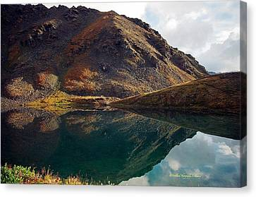 Summit Lake Reflection Canvas Print by Laura Lowrey