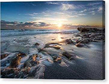Sun Rays On The Ocean Canvas Print by Debra and Dave Vanderlaan