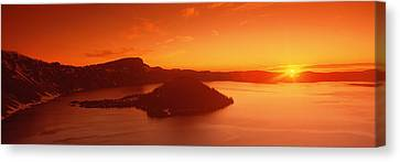 Sun Rising Over Crater Lake National Canvas Print by Panoramic Images