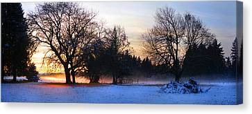 Sun Setting On Snow With Fog On The Ground Behind Canvas Print by Harold Greer