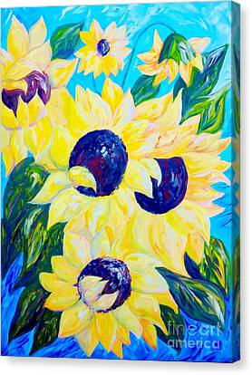 Sunflowers Bathed In Light Canvas Print by Eloise Schneider