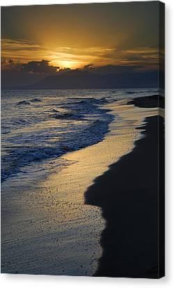 Sunrays Over The Sea Canvas Print by Guido Montanes Castillo