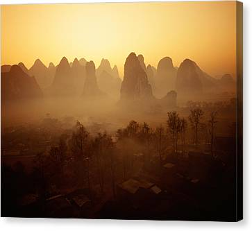 Sunrise In Mountains Guilin China Canvas Print by Panoramic Images