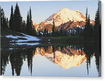 Sunrise Over A Small Reflecting Pond Canvas Print by Stuart Westmorland