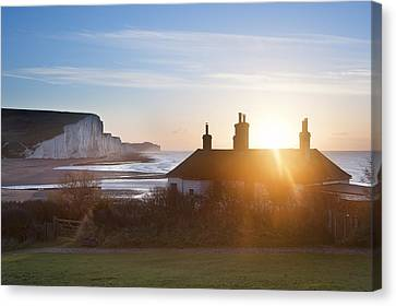 Sunrise Over Coastguard Cottages At Seaford Head With Seven Sist Canvas Print by Matthew Gibson