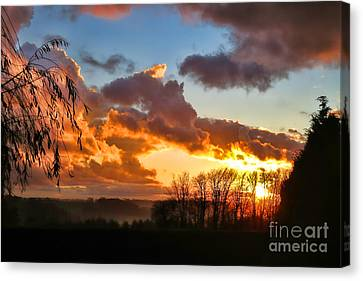 Sunrise Over Countryside Canvas Print by Olivier Le Queinec