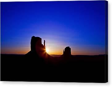 Sunrise Over Monument Valley Canvas Print by Susan Schmitz