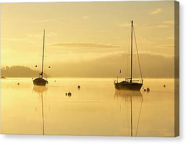 Sunrise Over Sailing Boats Canvas Print by Ashley Cooper