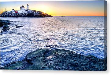 Sunrise Starburst Over Nubble Lighthouse  Canvas Print by Thomas Schoeller
