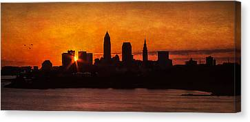 Sunrise Through The City Canvas Print by Dale Kincaid