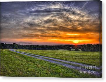 Sunset And The Road Home Canvas Print by Reid Callaway