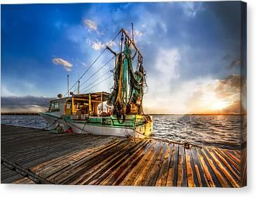 Sunset Fishing Canvas Print by Debra and Dave Vanderlaan