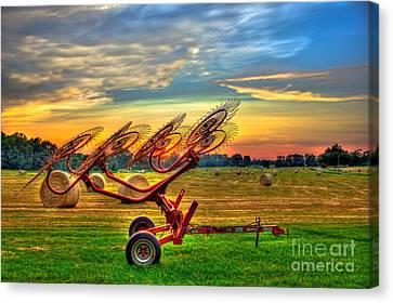 Sunset Hayrake Resting Canvas Print by Reid Callaway
