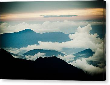 Sunset Himalayas Mountain With Clouds Canvas Print by Raimond Klavins