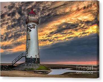 Sunset Lighthouse Canvas Print by Adrian Evans