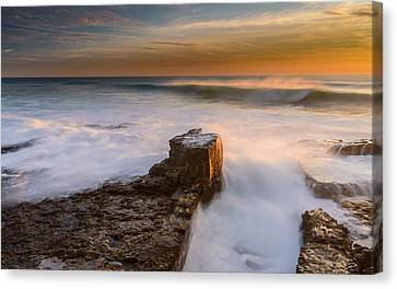Sunset Over A Rough Sea II Canvas Print by Marco Oliveira