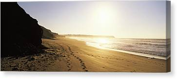 Sunset Over The Beach, Lagos, Faro Canvas Print by Panoramic Images