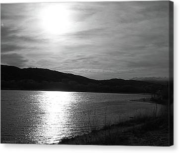 Sunset Over The Lake Canvas Print by Glenn McCarthy Art and Photography