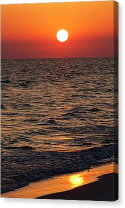 Sunset Over The Ocean And A Beach Canvas Print by Jim Edds