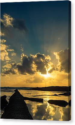 Sunset Over The Ocean Iv Canvas Print by Marco Oliveira
