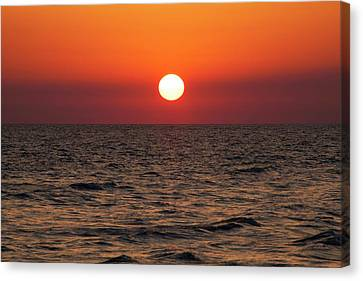 Sunset Over The Ocean Canvas Print by Jim Edds