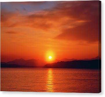 Sunset Over The Olympic Mountains Canvas Print by Jaynes Gallery